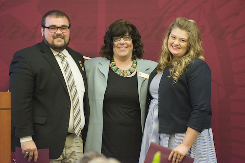 Business Club Scholarship Recipients Dylan Yeck and Holly Baer with Club Advisor Dr. Patricia Berg