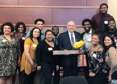 Walsh student leaders involved in Cultural Connections present President Jusseaume with engraved plaque