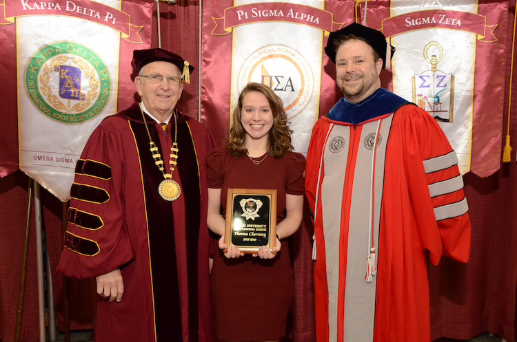 President Richard Jusseaume, Outstanding Student Theresa Chervney and Provost Dr. Douglas Palmer