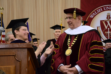 Board President Sarah Lioi presents President Richard Jusseaume with the Walsh Honorary Doctorate