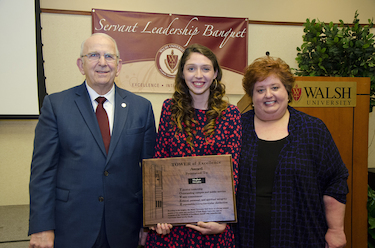 President Richard Jusseaume, Tower of Excellence Recipient Meghan Skrypka and Vice President for Student Affairs Amy Malaska