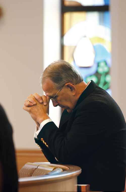 President Richard Jusseaume in Prayer